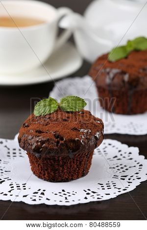 Yummy chocolate cupcake on table