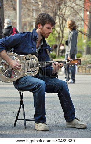 Blues Man Playing Dobro Guitar In New York