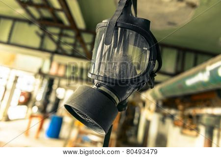 Gasmask hanging from cieling