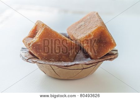 Gur - A jaggery cakes in an earthen bowl