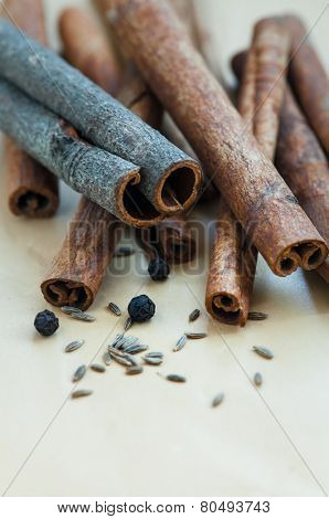 Many Cinnamon sticks cumin seeds and black pepper.