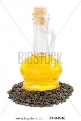 sunflower oil and seeds isolated at white background