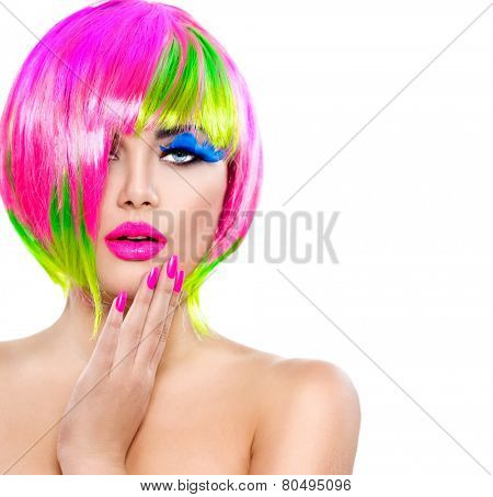 Beauty Fashion Model Girl with Colorful Dyed Hair, pink nails. Haircut with fringe. Colourful short Hair. Portrait of Beautiful Girl with Dyed Hair, professional hair Coloring. Colouring hair