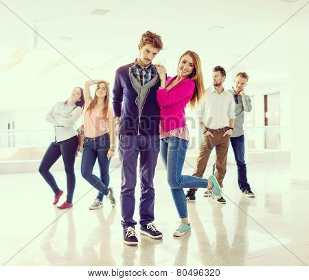 Cheerful students standing in hallway high school