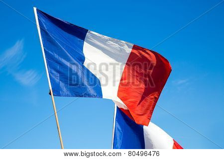 Flag of France, waving in the wind, on the sky