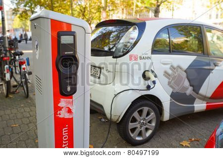 DUSSELDORF, GERMANY - SEP 16: charfing electro car on September 16, 2014. Dusseldorf is the capital city of the German state of North Rhine-Westphalia and centre of the Rhine-Ruhr metropolitan region