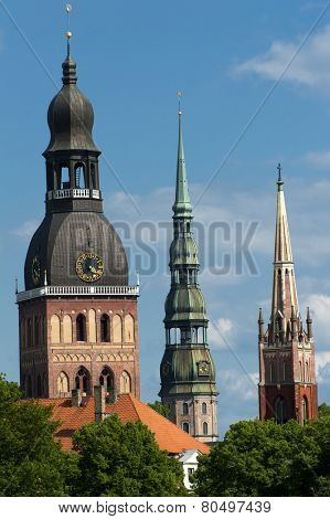 Three church towers in the picture are the Riga Dome cathedral,  St. Saviour's Church and St. Peter's church.