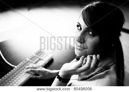 Woman sitting at helpdesk