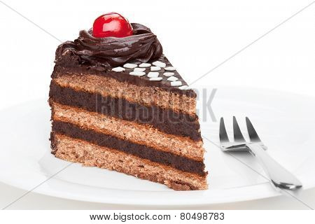 Piece of chocolate cake with cherry decoration,  isolated on the white background.