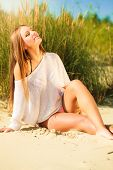picture of dune grass  - Young woman female model posing outdoor on background of dunes sky and grass - JPG