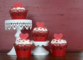 pic of red velvet cake  - Happy Valentine red velvet cupcakes with love messages on red vintage wood background - JPG
