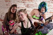 foto of groupies  - Young all girl punk rock band performs in a warehouse - JPG
