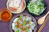 stock photo of rice noodles  - Vietnamese food Banh Cuon name Rice noodle roll or rolled cake is made from rice batter filled with mushroom pork served with Vietnam pork sausage sliced cucumber bean sprouts and sauce - JPG