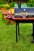 image of souse  - BBQ Party Sign on Wooden Heart at Barbecue Appliance on the Backyard at Summertime - JPG