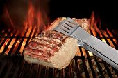 stock photo of tong  - Tongs Holding Grilled Pork Ribs - JPG
