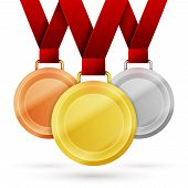 stock photo of medal  - Set of winner medals with red ribbon isolated on white - JPG