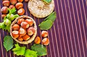 image of cobnuts  - hazelnuts on plate and on a table - JPG