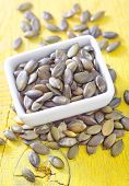 picture of fibrin  - pumpkin seed in bowl and on a table - JPG