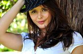pic of pimp  - Beautiful model outside with black and white pimp hat - JPG