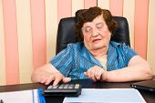 Elderly Corporate Woman Working Oin Office