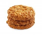 picture of baked raisin cookies  - Several oatmeal cookies in a stack on a white background - JPG