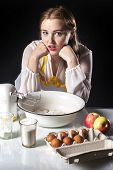 image of homemaker  - Photo of young smiling homemaker in kitchen - JPG