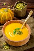 picture of butternut  - Homemade Autumn Butternut Squash Soup rustic brown wooden table - JPG