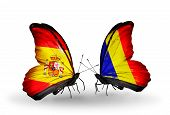 foto of chad  - Two butterflies with flags on wings as symbol of relations Spain and Chad Romania - JPG