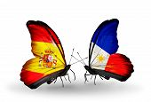 pic of spanish money  - Two butterflies with flags on wings as symbol of relations Spain and Philippines - JPG