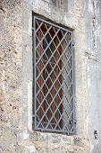 picture of grating  - Rustic window with grates close up view - JPG