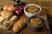 foto of french pastry  - It is the French onion soup with baked toast with cheese on top rustic pastry - JPG