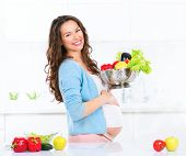 image of vegetable food fruit  - Pregnant Young Woman Cooking vegetables - JPG