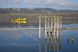 stock photo of dredge  - Dredging boats in the Columbia River Oregon - JPG