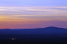 pic of nightfall  - Nightfall up North over forests hills - JPG