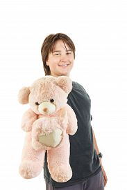 pic of sympathy  - cute young male chubby kid or boy smiling and holding teddy bear toy as gift for girl sympathy on white background - JPG