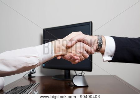 Handshake Of Two Equal Associates Over The Desk