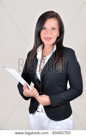 Smiling businesswoman with white file