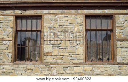 Stone Cladding Plates On The Wall With Windows
