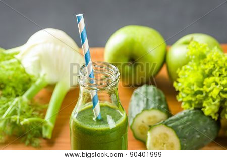 Green Smoothie In A Bottle With Fresh Fruits And Vegetables