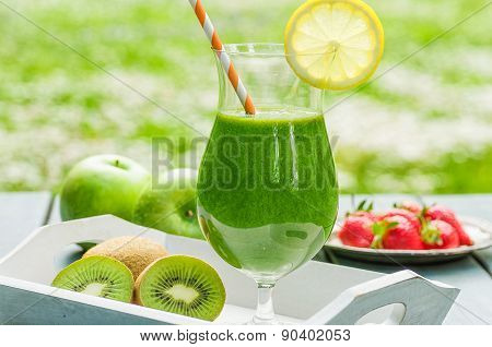 Smoothie In A Cocktail Glass With Fresh Fruits