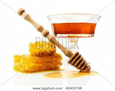 Honey With Honeycomb And Wooden Dipper