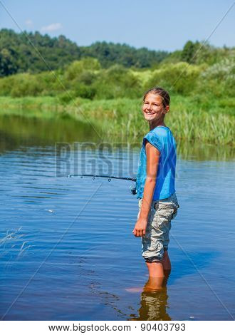 Girl fishing on the river.
