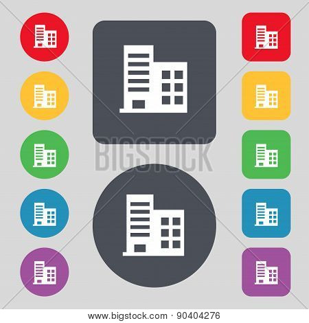 High-rise Commercial Buildings And Residential Apartments Icon Sign. A Set Of 12 Colored Buttons. Fl
