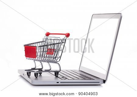 Shopping cart on laptop computer, e-comerce concept