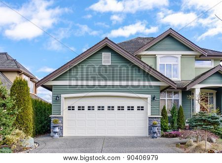 Two-car garage of a luxury house against blue sky in Vancouver Canada.