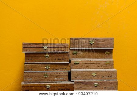 Cuban Sigar Boxes On A Yellow Wall