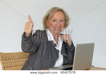 Active Blond Senior Woman Showing Thumb Up