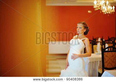 Bride With Tiara Pose At The Restauraunt