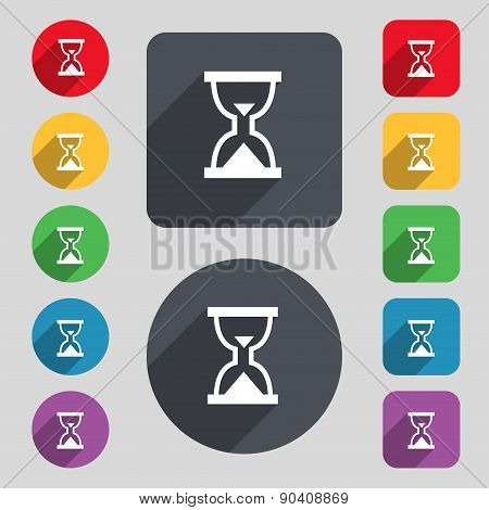 Hourglass, Sand Timer Icon Sign. A Set Of 12 Colored Buttons And A Long Shadow. Flat Design. Vector