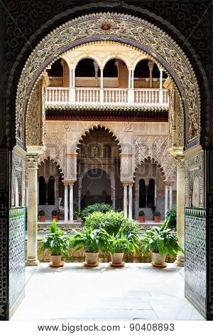 SEVILLE, SPAIN - MARCH 15, 2013: Courtyard in Real Alcazar Palace, masterpiece of moorish architecture 14th century